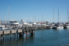 Sailboats, Yachts and Catamarans. FREMANTLE,WA,AUSTRALIA-NOVEMBER 13,2016: Royal Perth Yacht Club marina and luxury yachts, sailboats and catamarans under a royalty free stock photo