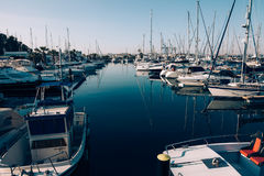 Sailboats and yachts in in harbor. Transportation royalty free stock image