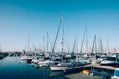 Sailboats and yachts in in harbor. Transportation royalty free stock photography