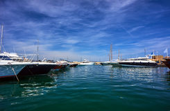 Sailboats and yachts moored to the quay port of Saint-Tropez Stock Photography