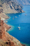 Sailboats and yachts near volcanic rocks of Santorini island, Greece Stock Photography