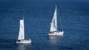 Sailboats or yachts sailing in the open sea stock video