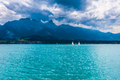 Sailbots on the Sea With View of Mountains Royalty Free Stock Photography