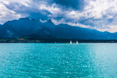 Sailbots on the Sea With View of Mountains Stock Image
