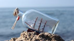Sailcloth ship in bottle Stock Photos