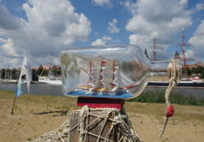 Sailcloth ship in bottle Stock Images