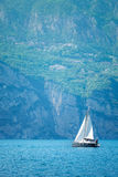 Sailer boat floating by waves of lake Royalty Free Stock Image