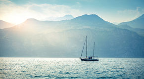 Sailer boat sailing by sea waves in evening Royalty Free Stock Photos