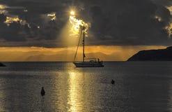 Sailer crossing the sun glitter Royalty Free Stock Image