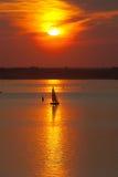 Sailer at sunset Stock Images