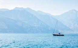 Sailer at water of lake bay Stock Image