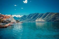 Sailfish and harbor at sunny day in Boka Kotor bay Boka Kotorska, Montenegro, South Europe royalty free stock photography