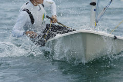 Sailing 011. A sailor rides along in the boat Stock Photography