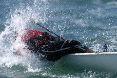 Sailing 1. A sailor is covered by the water from a wave Stock Image