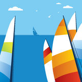 Sailing. Colored sail the open air and sea Royalty Free Stock Image