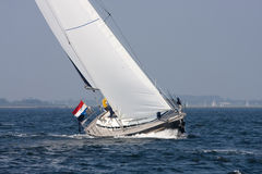 Sailing. A yacht is cruising in a moderate breeze in lake Grevelingen, Netherlands Royalty Free Stock Photo
