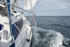 Sailing. View from a sailing yacht, sailing in a good wind on lake Grevelingen Stock Images