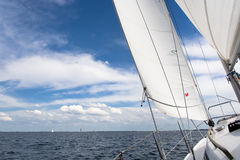 Sailing. View from a sailing yacht, sailing in a nice breeze on a blue lake Grevelingen Stock Photos