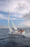 Sailing. Team on a sailing cruise Royalty Free Stock Images
