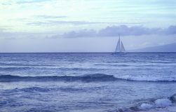 Sailing. Sailboat in the distance, hawai Stock Images