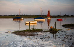 Sailing. Boats in Morston creek at high tide Stock Images