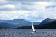 Sailing. Sailboat in a lake at the mountains Stock Photography