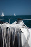 Sailing. Boat's deck: sailing equipment, yachts in background Stock Photo