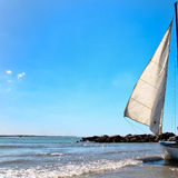 Sailing. A sail is blown by the wind Royalty Free Stock Images