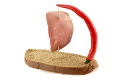 Sailing. Ship made of bread with sail made of ham and pepper Stock Photo