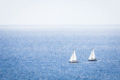 Sailing. Two sailboats - back lit - italy - nice background with space for text Stock Image