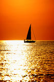 Sailing. Sailboat at sunset on Lake Michigan, in Michigan City, indiana Royalty Free Stock Photo