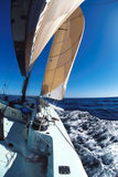 Sailing 5. The sail of a sailboat amongst a blue sky Royalty Free Stock Photography