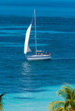 Sailing. Sailboat in tropical turqoise waters Royalty Free Stock Images