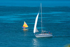 Sailing. Sailboat in tropical turquoise waters Royalty Free Stock Photo