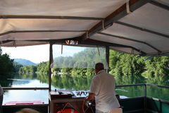 Sailing on the Adda River. Within the Adda Nord Park, on board of `Addarella`, with a capacity of 48 people, a boat with silent and ecological electric motors Royalty Free Stock Photos