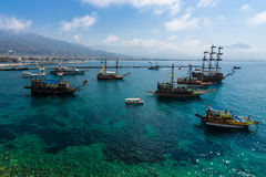 Sailing aka pirate ships around the fortress of Alanya. Stock Photo