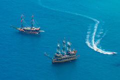 Sailing aka pirate ships around the fortress of Alanya Stock Photo