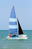 Sailing Alone 2. A man sails his small sailboat alone heading south royalty free stock photography