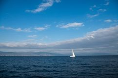 Sailing alone in the sea stock images