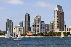 Sailing Along The Bay Waterfront in San Diego. Sailboats sailing on a sunny summer afternoon in the bay of San Diego Royalty Free Stock Photo