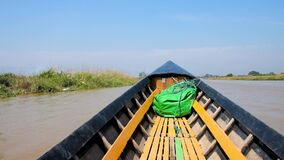 Trip on canoe boat, Inle Lake, Myanmar. Sailing along the canal of Inle lake with a view on canoe boat`s bow, agricultural lands, floating farms, fishing village stock footage