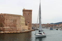 Sailing along Fort Saint-Jean, Marseille, France Stock Images