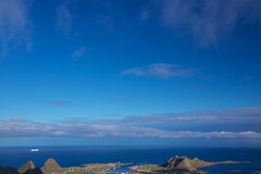 Sailing along norwegian coast. Luxurious cruiser under blue skies sailing along picturesque norwegian coast Stock Photo