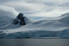 Antarctica smooth snowy mountains on cloudy day stock photography
