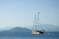 Sailing away. Wooden sail boat cruising on the mediterranean Stock Photography