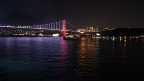 Sailing away from Istanbul`s bridge at night stock video
