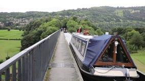 Sailing barge over Pontcysyllte Aqueduct Llangollen Wales UK stock video