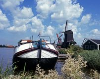 Sailing barge and windmill, Zaanse Schans, Holland. Stock Photo