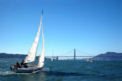 Sailing The Bay. A great day for sailing the San Francisco Bay. The Golden Gate Bridge is in the background royalty free stock image