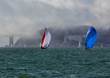Sailing in bay Stock Images
